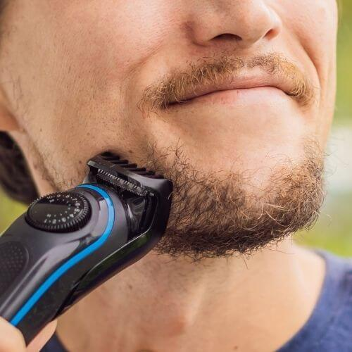 should you trim your beard when growing it out